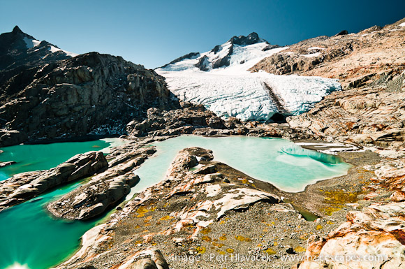 Mt. Brewster dominating the Brewster Glacier with its terminal lakes - Mt. Aspiring N.P., West Coast, New Zealand